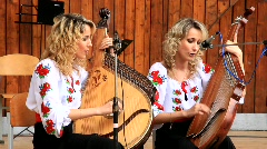 Beautiful twin sisters playing banduras (Ukrainian string instrument) Stock Footage