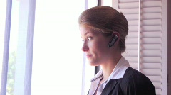 Female Executive Businesswoman Talking on Bluetooth Headset Stock Footage