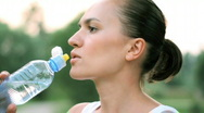 Stock Video Footage of Woman drinking water after sport activities, shot at 60fps