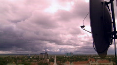 Storm Clouds over the city timelapse Stock Footage