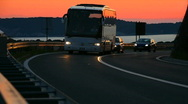 Car and buss driving in sunset color Stock Footage