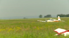 Aircraft, Mooney aircraft takeoff, #2 on rural grass strip Stock Footage