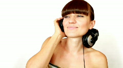 Attractive woman with headphones isolated over a white background Stock Footage