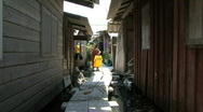 Asian Woman In Slums Hanging Clothes To Dry Stock Footage