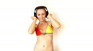 Stock Video Footage of Attractive woman in bikini with headphones