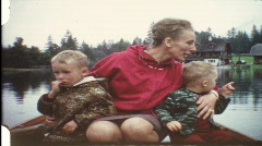 Mother with children in rowboat (vintage 8 mm amateur film) Stock Footage