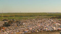 The environment, garbage dump, #11 and compactor wide shot Stock Footage