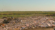 Stock Video Footage of the environment, garbage dump, #11 and compactor wide shot