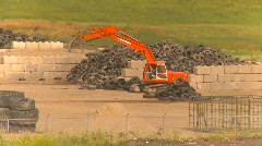 The environment, tire recycle facility with backhoe Stock Footage