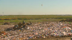 the environment, garbage dump, #16 and tractors, wide shot - stock footage