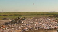 Stock Video Footage of the environment, garbage dump, #16 and tractors, wide shot