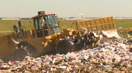 Stock Video Footage of the environment, landfill garbage dump and compactor, #3 forward and reverse