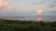 Moon Set & Sunrise At The Beach Stock Footage