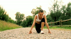 Young woman preparing to run, dolly shot Stock Footage