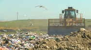 Stock Video Footage of the environment, garbage dump, #5 and compactor, follow shot
