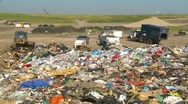 Stock Video Footage of the environment, garbage dump, #19 and trucks, garbage foreground, wide shot