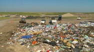 Stock Video Footage of the environment, garbage dump, #17 and trucks, wide shot