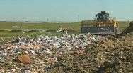Stock Video Footage of the environment, garbage dump, #10 and compactor, through frame