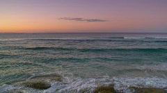 Waves Break on Rocky Shore, Purple Dusk Sky Stock Footage