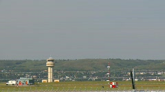 Aircraft, Bombardier RJ jet landing through frame with ATC tower in background Stock Footage