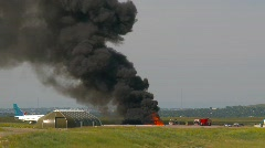 Airport fire training, #10 wide shot with aircraft Stock Footage