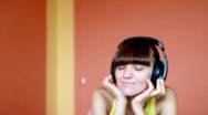 Stock Video Footage of Attractive woman with headphones listening to music, dolly shot
