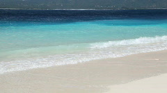 Summertime tropical island white sand beach Stock Footage