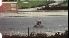 Little boy on trike (vintage 8 mm amateur film) Stock Footage