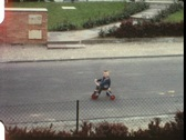 Stock Video Footage of Little boy on trike (vintage 8 mm amateur film)