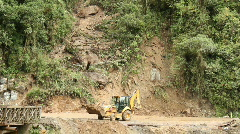 Clearing a landslide on a dangerous mountain road Stock Footage