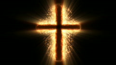 Religious cross on fire and sparkles Stock Footage