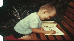 Little boy drawing picture (vintage 8 mm amateur film) Stock Footage