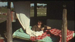 On Safari, sleeping in mosquito net (Vintage 8 mm amateur film) Stock Footage