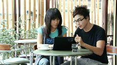 Asian Couple at the Cafe - stock footage