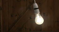 Stock Video Footage of Flickering swinging light bulb