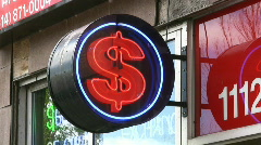 Neon Illuminated Dollar Sign Outside A Check Cashing Store - stock footage