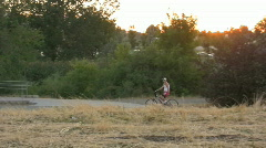 Man Rides His Bike On The Parkway In the Woods 3 Stock Footage