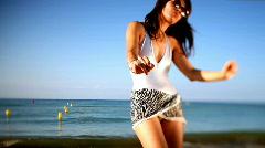 Beautiful woman beach sea fun Stock Footage