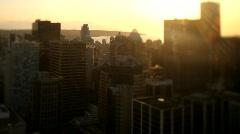 city skyline at sunset overview shift+tilt - 7D - stock footage