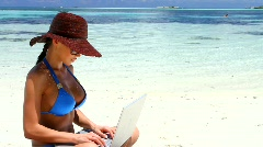 Beautiful woman working on laptop near water at Maldives - stock footage