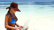 Stock Video Footage of Beautiful woman working on laptop near water at Maldives