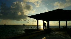 Romantic couple standing next to water house - stock footage