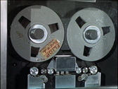 Stock Video Footage of Reel to Reel magnetic computer tape reader COM016