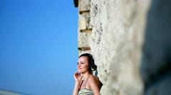 Attractive woman with headphones outdoor, zoom in   Stock Footage