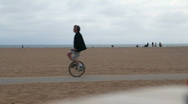 Stock Video Footage of Beach Fitness 07: Unicycling