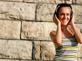 Stock Video Footage of Attractive woman with headphones outdoor, tracking shot