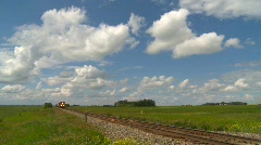Railroad, fast freight train on the prairies, through frame Stock Footage