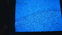 TV Television in dark room Stock Footage