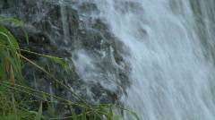 Small waterfall flowing from a cliff Stock Footage