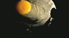 Fried egg on black pan Stock Footage